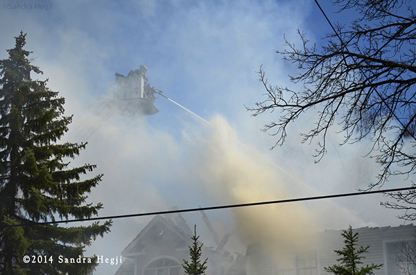 tower ladder with smoke at fire scene