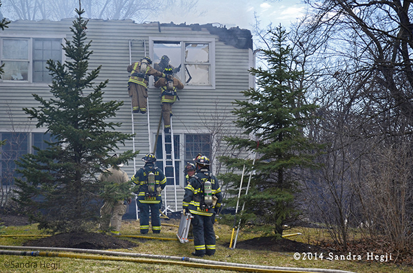 firemen at house destroyed by fire