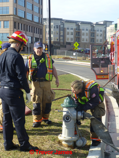 female firefighter at fire hydrant
