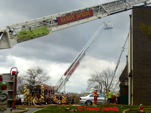 two tower ladders work at fire scene