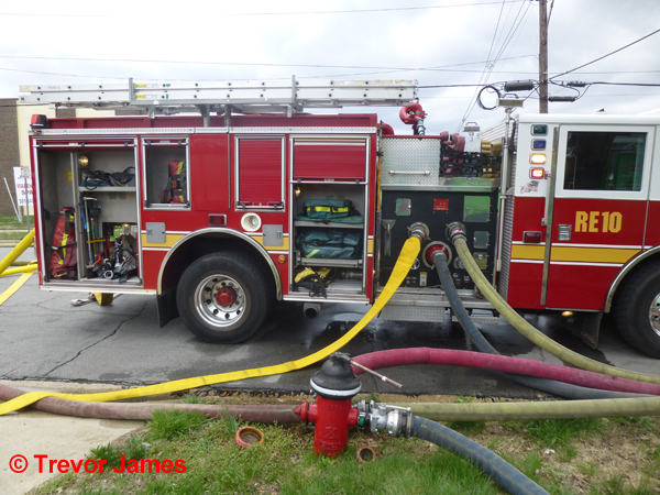 fire engine with hose lines at fire hydrant