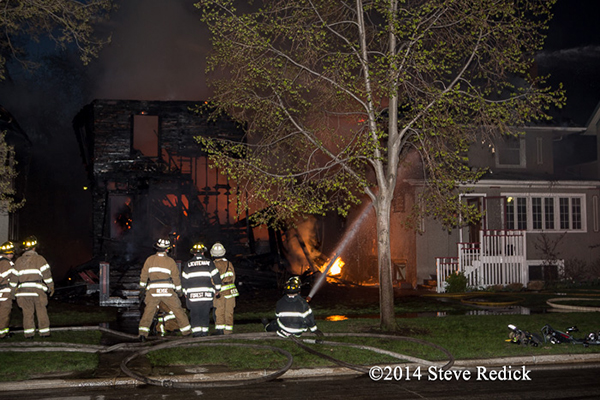 firemen working at night fire scene