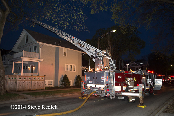 Seagrave fire truck working at night fire scene