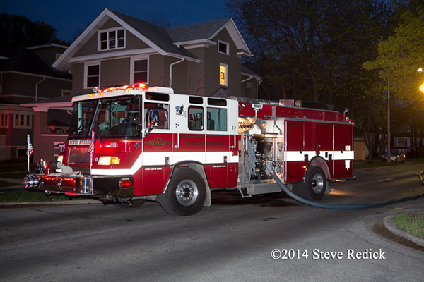 Pierce fire truck working at night fire scene