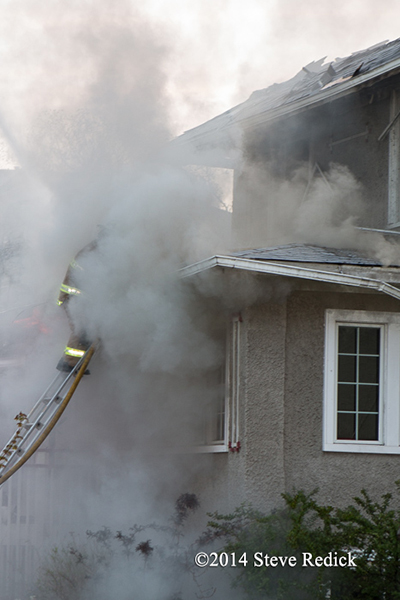 firemen engulfed in smoke at house fire