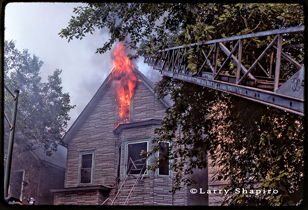 flames from attic at house fire
