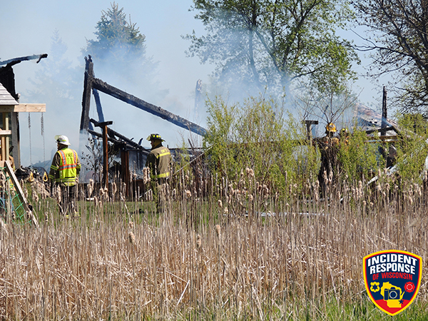 Firemen at the scene of a barn fire