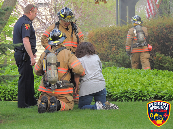 firefighters rescue woman from house fire