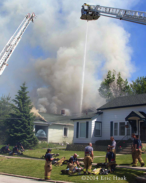 elevated master stream at house fire with lots of smoke