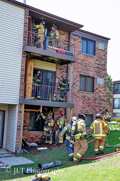 firefighters after fighting apartment building fire