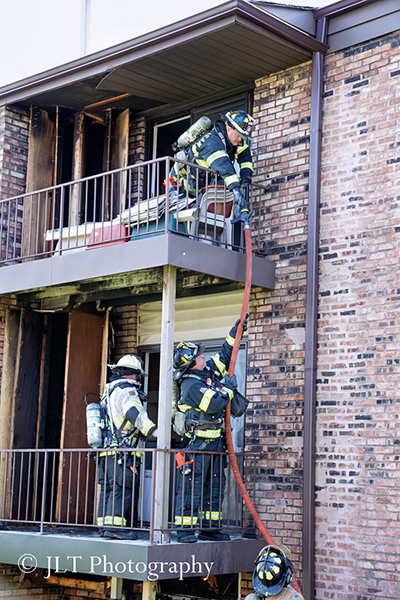 firemen chase hot spots after fire