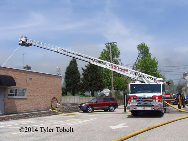 Pierce tower ladder working at fire scene