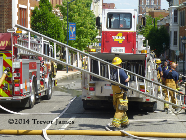 fireman putting ladder away after fire