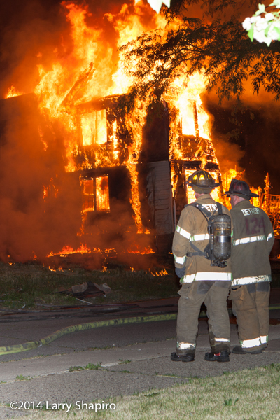 Detroit firemen with fully-engulfed dwelling