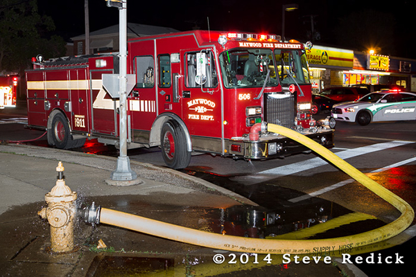 fire engine at night on hydrant
