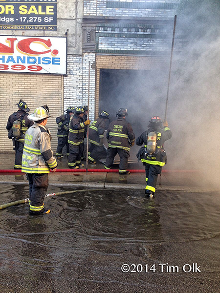 firefighters at warehouse fire in Chicago