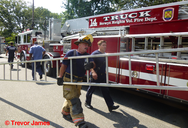 fireman carries ladder