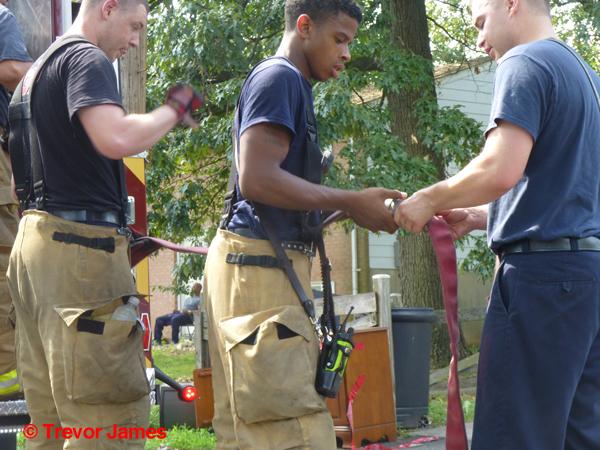 young firefighters couple hose