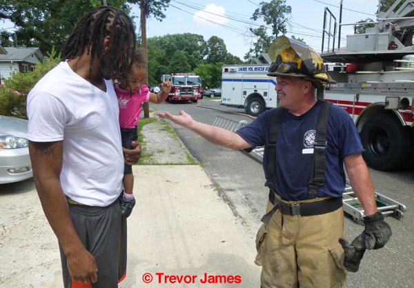 fireman talks with resident