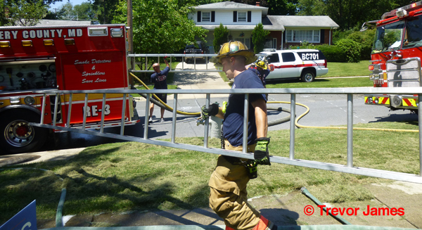 fireman carries a ladder