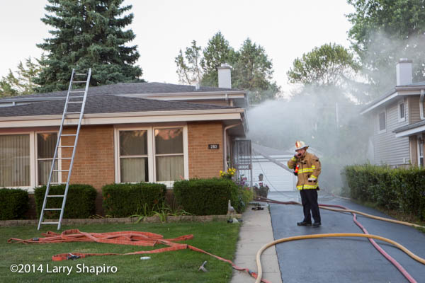 fire chief in command outside a house fire