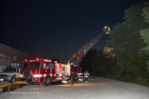 E-ONE tower ladder at night