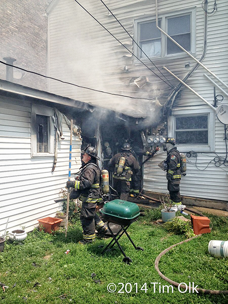 firemen at a house fire