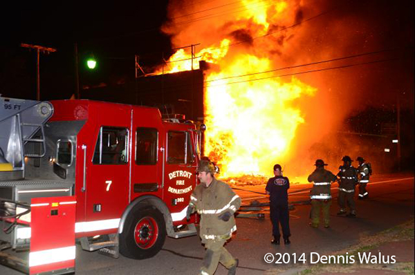 vacant commercial building in Detroit fully involved in fire