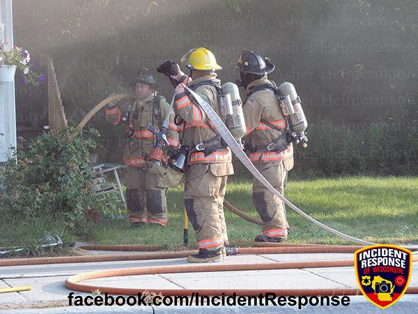 firemen with hose