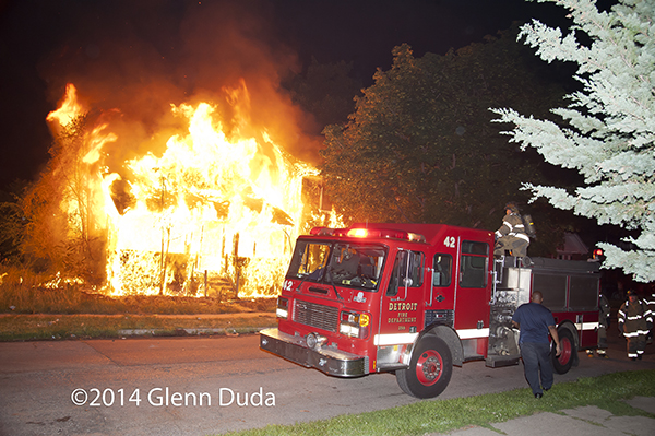 house in Detroit fully-engulfed in flames