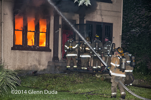 Detroit firemen battling a house fire