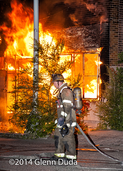 Detroit fireman at nighttime arson fire