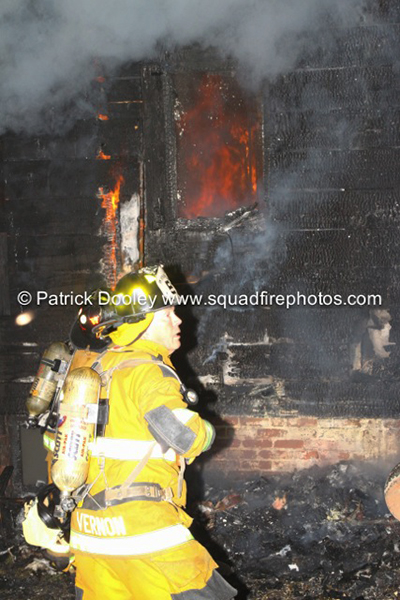 fireman works at fire scene