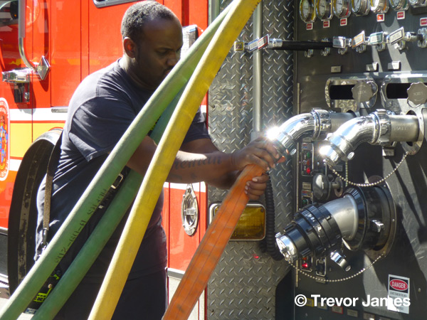 fireman with hose lines at pumper