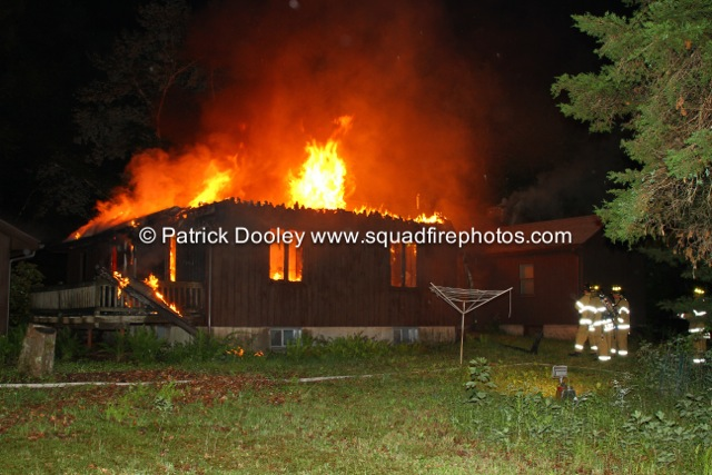 house fully-engulfed in fire at night