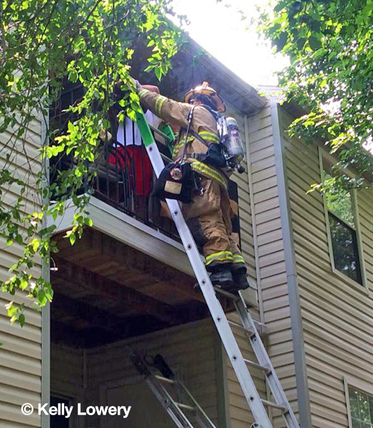 firemen rescue occupant from balcony