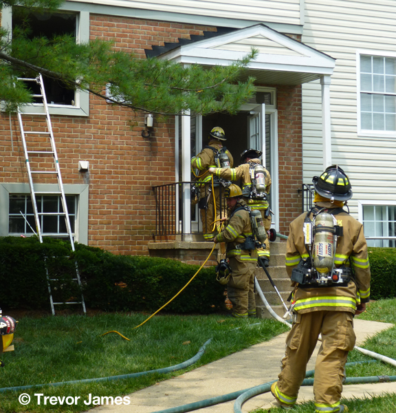 firemen with hose line at front door