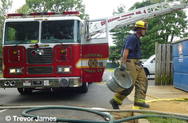 firemen pickup tools at a fire scene