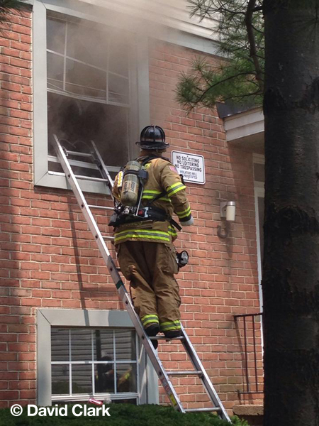 fireman on ladder vents window
