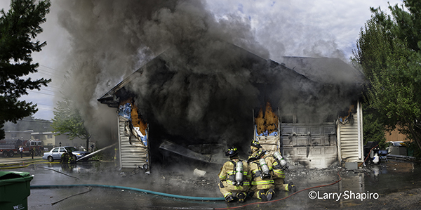 firefighters attack a garage fire