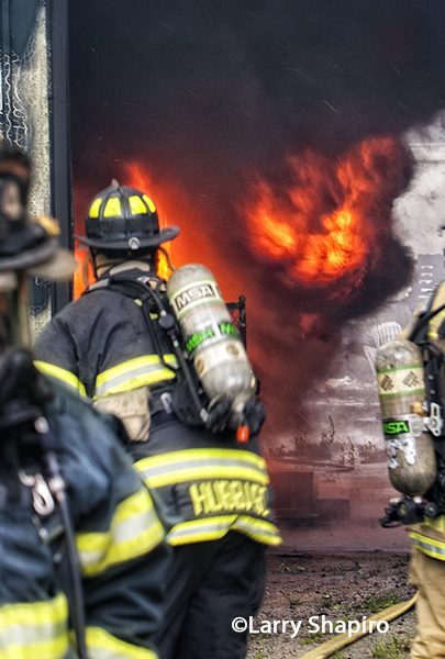 firefighter advancing towards flames