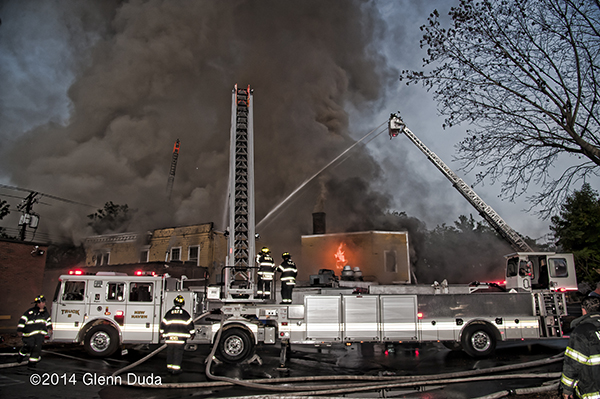Seagrave tractor-drawn aerial working at huge fire scene