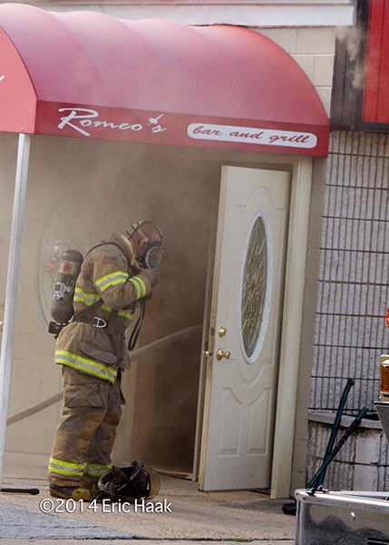 fireman masking up before entry