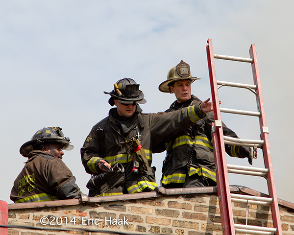 firemen on building roof
