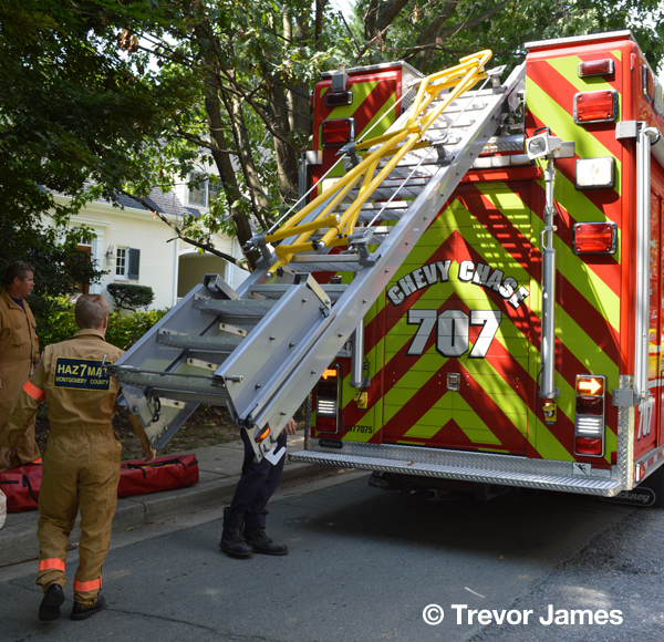 firemen remove gear from squad unit