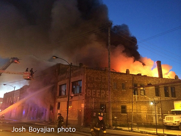 flames through the roof at a commercial building fire in Chicago