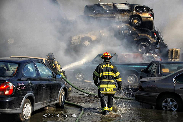 firemen battle fire in a junkyard