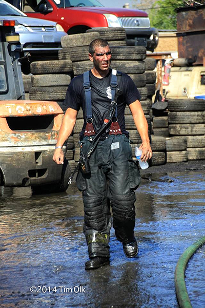 fireman after battling a fire on a very hot day