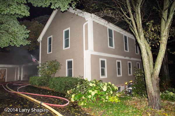 smoke from house at night with basement fire