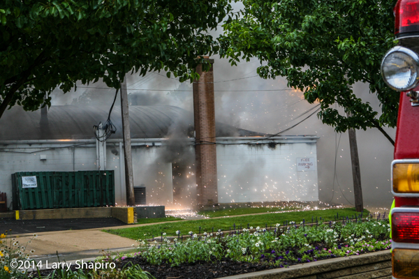 sparks fly from building charged by downed power lines